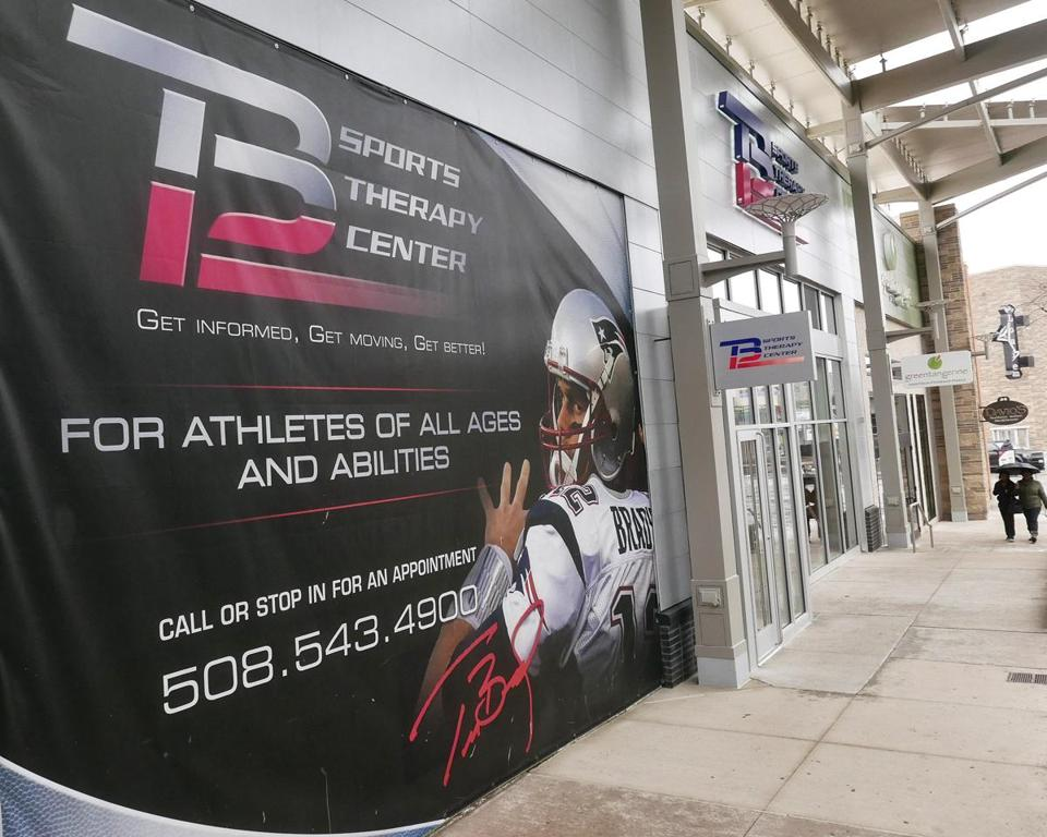 The exterior of the TB12 Sports Therapy Center among the other stores at Patriot Place adjacent to Gillette Stadium in Foxborough, Mass.